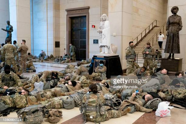 Members of the National Guard rest in the Visitor Center of the U.S. Capitol on January 13, 2021 in Washington, DC. Security has been increased...