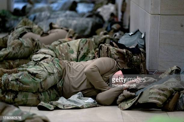 Members of the National Guard sleep in the U.S. Capitol on January 14, 2021 in Washington, DC. Security has been increased throughout Washington...