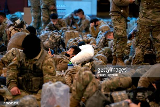 Members of the National Guard sleep in the Visitor Center of the U.S. Capitol on January 13, 2021 in Washington, DC. Security has been increased...