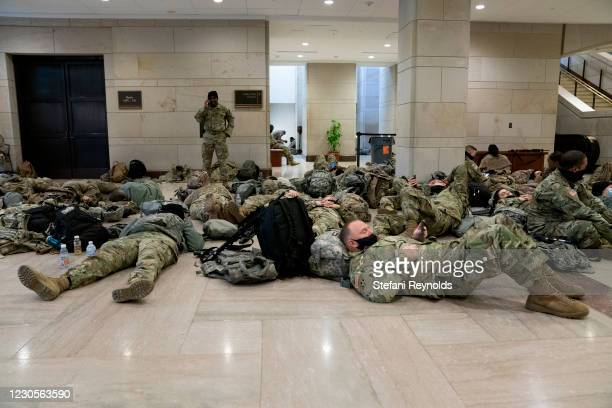 Members of the National Guard sleep on the floor of the U.S. Capitol on January 13, 2021 in Washington, DC. Security has been increased throughout...