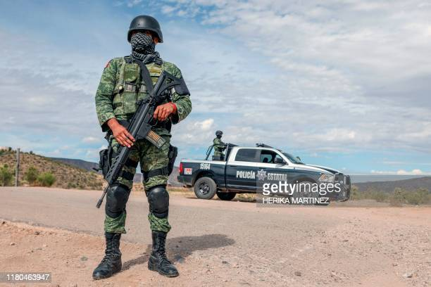 Members of the National Guard stand guard near La Morita ranch belonging to the MexicanAmerican LeBaron family of which nine members were killed in a...