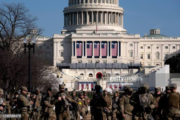 Members of the National Guard stand outside the U.S. Capitol on January 14, 2021 in Washington, DC. Security has been increased throughout Washington...