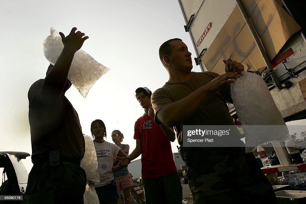 Members of the National Guard unload ice from a truck at a relief center September 12, 2005 in Waveland, Mississippi. Thousands of residents of the Gulf Coast are still without electricity or access to basic amenities after Hurricane Katrina swept through the area two weeks ago.