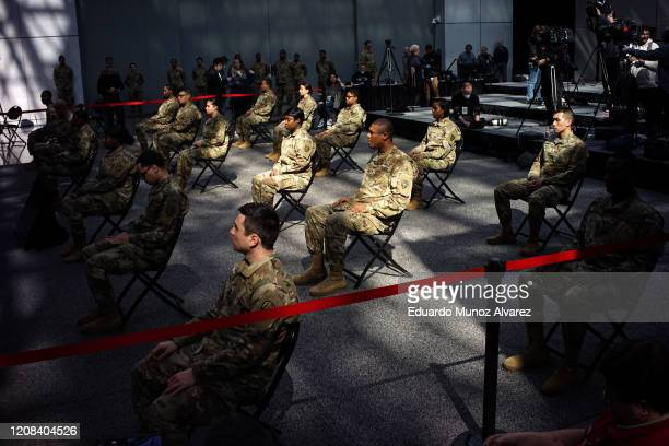 Members of the National Guard wait the arrival of New York Gov Andrew Cuomo at the Javits Convention Center, which is being turned into a hospital to...