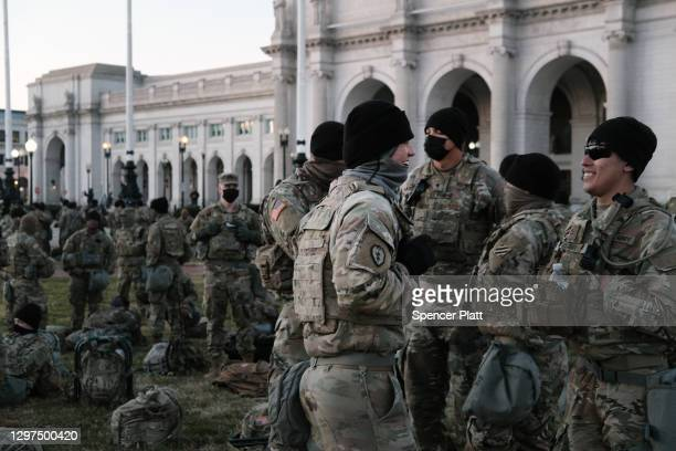 Members of the National Guard wait to depart Union Station as the city remains under tight security during the presidential inauguration on January...