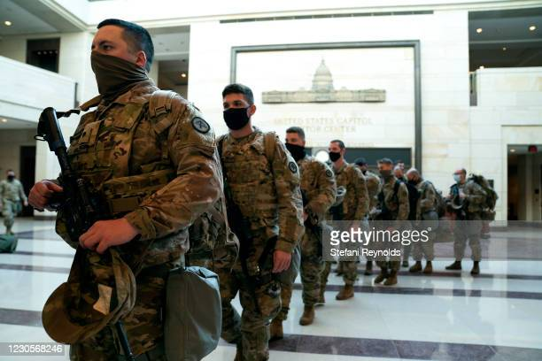 Members of the National Guard walk through the Visitor Center of the U.S. Capitol on January 13, 2021 in Washington, DC. Security has been increased...