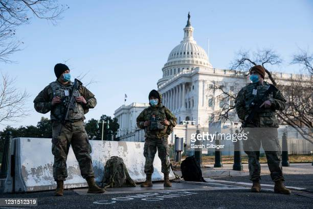 Members of the National Guard wear protective masks on duty outside of the U.S. Capitol on March 4, 2021 in Washington, DC. The House of...