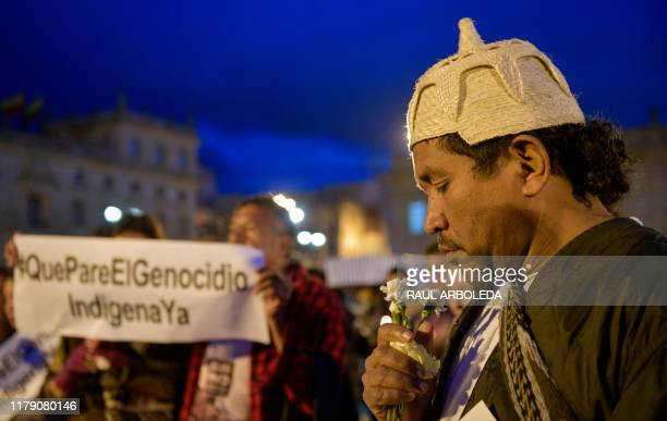 Members of the National Indigenous Organization of Colombia , activists and politicians attend a symbolic ceremony at Bolivar square in Bogota on...
