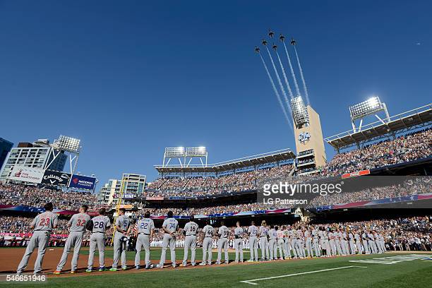 Members of the National League are seen on the base path during the National Anthem as a military flyover takes place prior to the 2016 MLB AllStar...