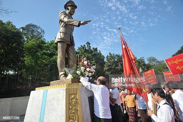 Members of the National League for Democracy party lay a wreath in front of the late General Aung San statue to mark the 100th birthday of...
