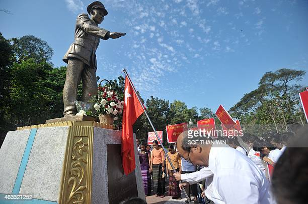 Members of the National League for Democracy pay their respects to late General Aung San statue to mark the 100th birthday of independence hero Aung...