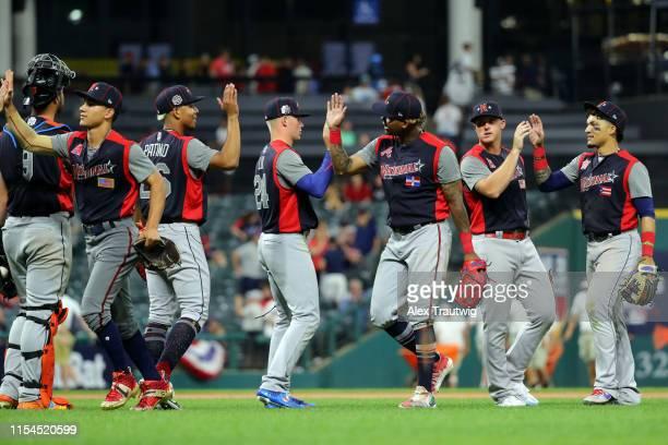 Members of the National League Futures Team celebrate tying the American League Futures Team in the SiriusXM All-Star Futures Game at Progressive...