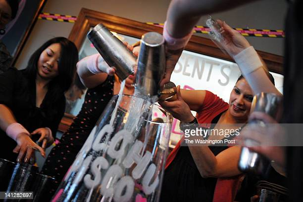 Members of the national LUPEC combine their pisco sour mixes into one big drink during their DC BRAS event at The Passenger on March 4 in Washington...