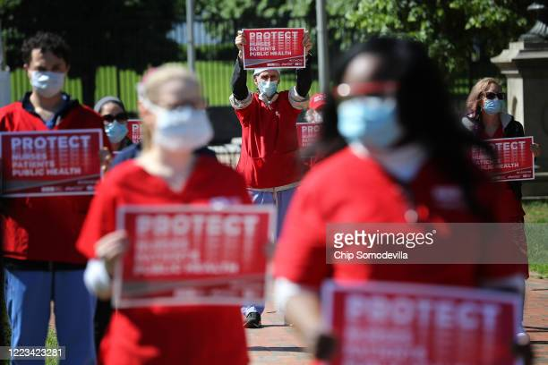Members of the National Nurses United read the names of 88 nurses they say have died from COVID-19 while demonstrating in Lafayette Park across from...