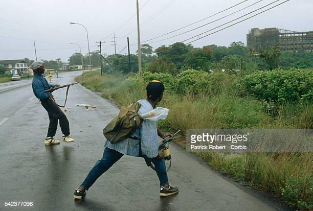 Members of the National Patriotic Front of Liberia engage in battle on their way to the Liberian capital Monrovia Responding to years of government...