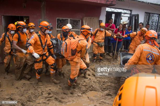 Members of the National Penitentiary Institute remove a corpse after the avalanche in Mocoa Colombia 04 April 2017
