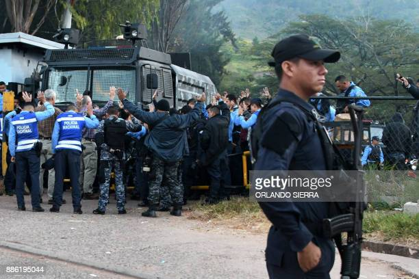 Members of the National Police and police officers belonging to COBRA Special Riot Command pray early morning at COBRA headquarters as they refuse to...