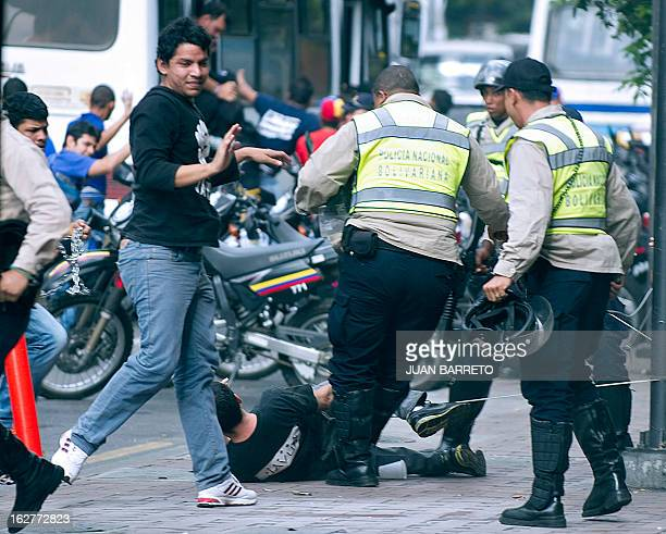 Members of the national police beat students as they demonstrate in Caracas on February 26 2013 The students were demonstrating believing that the...