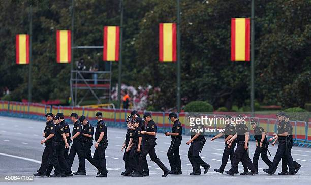 Members of the national police prepare before the coronation ceremony at the Cibeles square on June 19 2014 in Madrid Spain The coronation of King...