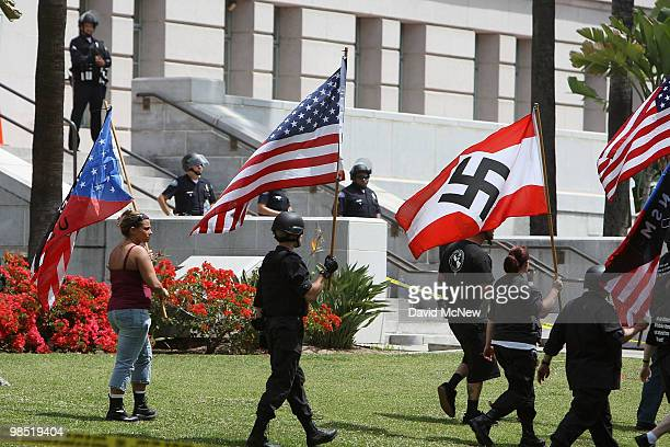 Members of the National Socialist Movement march across the City Hall lawn to begin their rally near City Hall on April 17 2010 in Los Angeles...