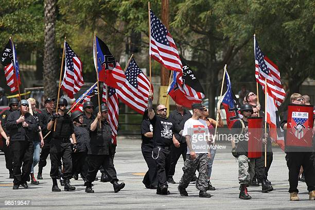 Members of the National Socialist Movement march to their rally near City Hall on April 17 2010 in Los Angeles California An NSM antiillegal...