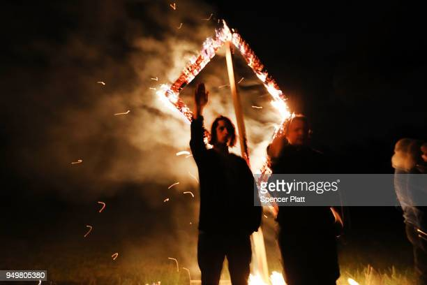 Members of the National Socialist Movement one of the largest neoNazi groups in the US hold a swastika burning after a rally on April 21 2018 in...