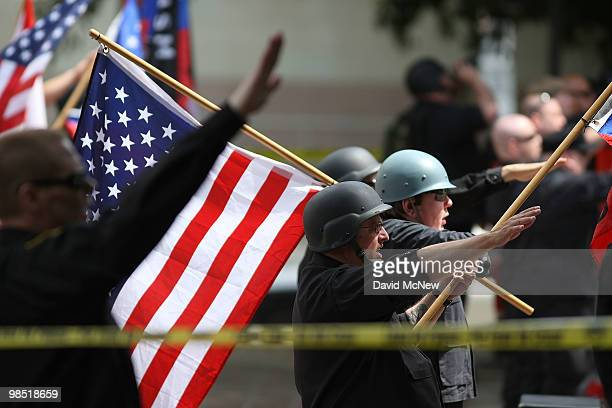 Members of the National Socialist Movement salute during a rally on near City Hall on April 17 2010 in Los Angeles California An NSM antiillegal...