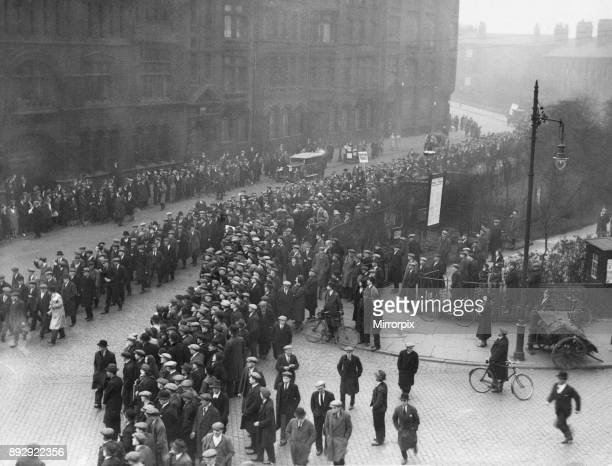 Members of the National Unemployed Workers Movement march through Ardwick Green Manchester to protest against the means test 25th April 1932