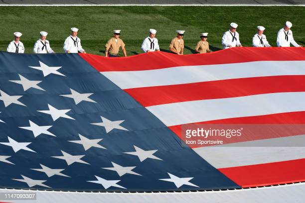 Members of the Navy and Marines hold a huge flag in the infield prior to the Monster Energy Coca Cola 600 on May 26 2019 at Charlotte Motor Speedway...