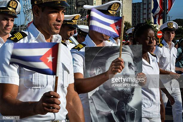 TOPSHOT Members of the Navy display a picture of Cuban former president Fidel Castro during the May Day parade at Revolution Square in Havana on May...