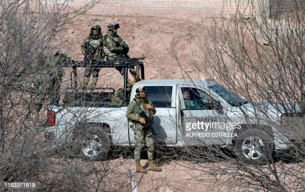 Members of the Navy keep watch at La Mora ranch, in Bavispe, Sonora State, Mexico, as Mexican President Andres Manuel Lopez Obrador holds a meeting...