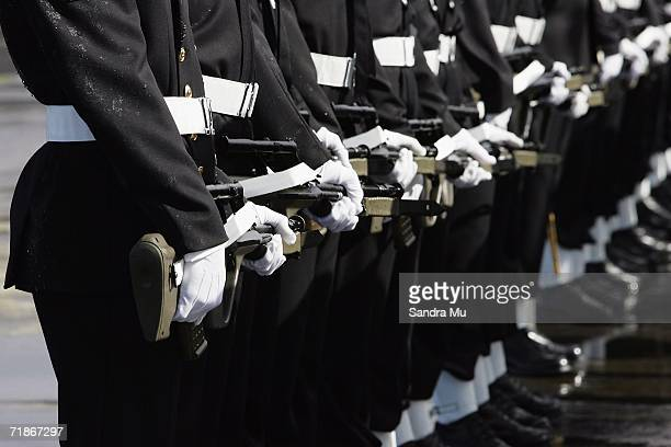 Members of the Navy line a guard of honour for the body of the Late Tongan King Taufa'ahau Tupou IV at Whenuapai Airbase September 13, 2006 in...