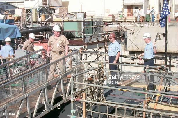 Members of the Navy''s Court of Inquiry disembark the USS Greeneville March 6 2001 in Drydock at the Pearl Harbor Naval Shipyard and Intermediate...