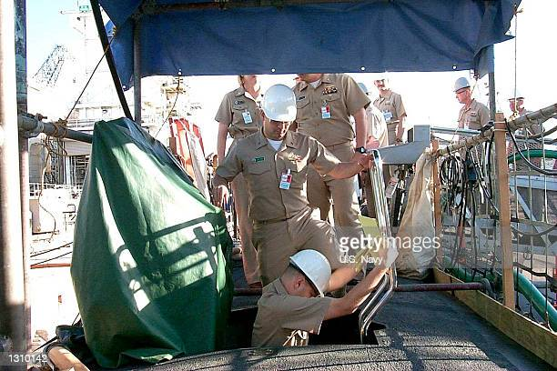 Members of the Navy''s Court of Inquiry go aboard the USS Greeneville March 6 2001 in Drydock at the Pearl Harbor Naval Shipyard and Intermediate...