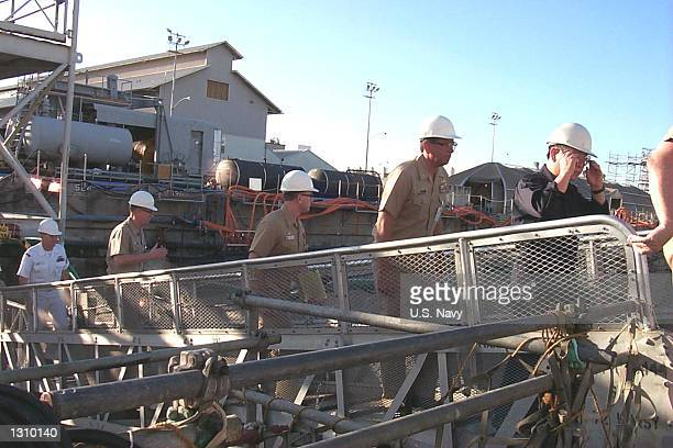 Members of the Navy''s Court of Inquiry walk up the brow to go aboard USS Greeneville March 6 2001 in Drydock at the Pearl Harbor Naval Shipyard and...
