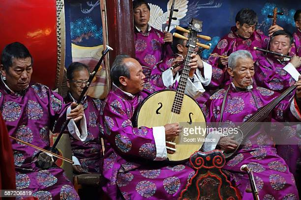 Members of the Naxi Orchestra as they perform with traditional instruments Lijiang Yunnan Province China 2012