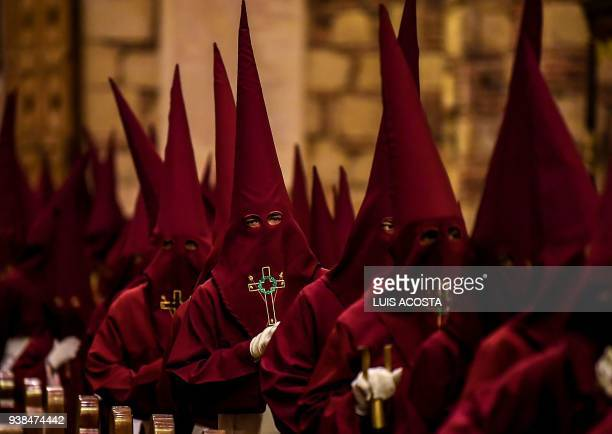 Members of the Nazarenos brotherhood take part in the Jesus Nazareno children's procession as part of Holy Week celebrations in Zipaquira Colombia on...