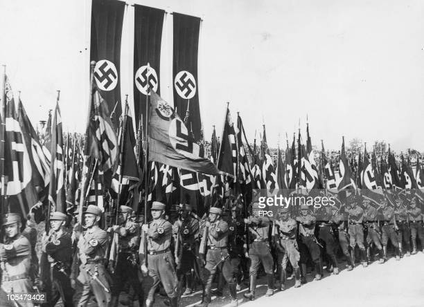 Members of the Nazi Sturmabteilung marching down the Luitpoldhain with their banners at the Nuremberg Rally to mark the 6th Nazi Party Congress 9th...