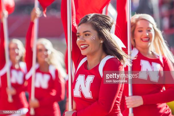 Members of the Nebraska cheerleading squad run through the end zone after their team scores during the game between the BethuneCookman Wildcats and...
