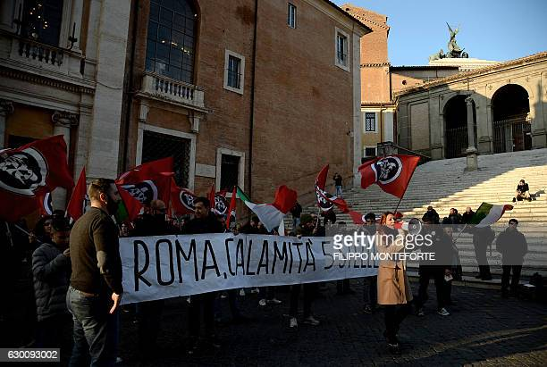 Members of the NeoFascist movement Casa Pound demonstrate as they hold a banner reading 'In Rome the FiveStar Movement is a disaster' during a town...
