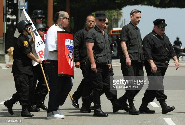 Members of the NeoNazi group The American National Socialist Movement arrive to hold a rally in front of the Los Angeles City Hall on April 17 2010...