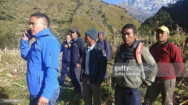 Members of the Nepali rescue team look on during the rescue operations for the bodies of nine climbers killed at Mount Gurja in the Dhaulagiri...