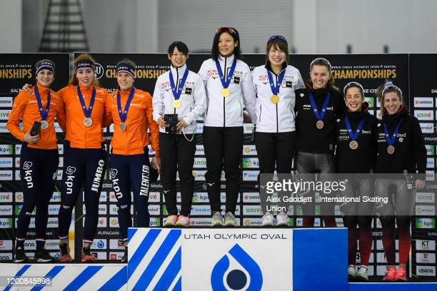 Members of the Netherlands, Japan and Canada stand on the podium after the ladies team pursuit during the ISU World Single Distances Speed Skating...