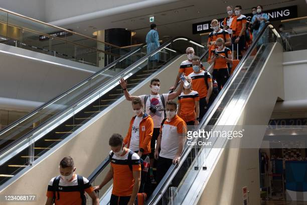 Members of the Netherlands Olympic team descend an escalator as they pass through Narita Airport on July 20, 2021 in Narita, Japan. With the Olympic...