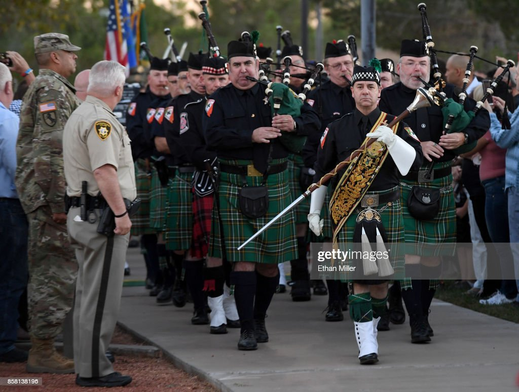Members of the Nevada Emerald Society Pipes & Drums band arrive at the start o a vigil for Las Vegas Metropolitan Police Department Officer Charleston Hartfield at Police Memorial Park on October 5, 2017 in Las Vegas, Nevada. Hartfield, who was off duty at the Route 91 Harvest country music festival on October 1, was killed when Stephen Paddock opened fire on the crowd killing at least 58 people and injuring more than 450. The massacre is one of the deadliest mass shooting events in U.S. history.