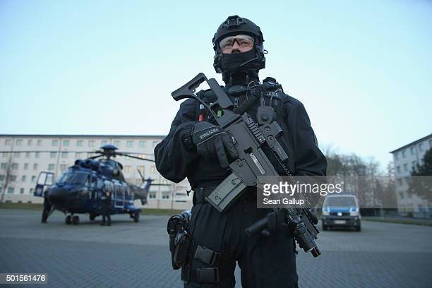 Members of the new BFEplus antiterror unit of the German federal police holds a G36C automatic weapon after taking part in a capabilities...