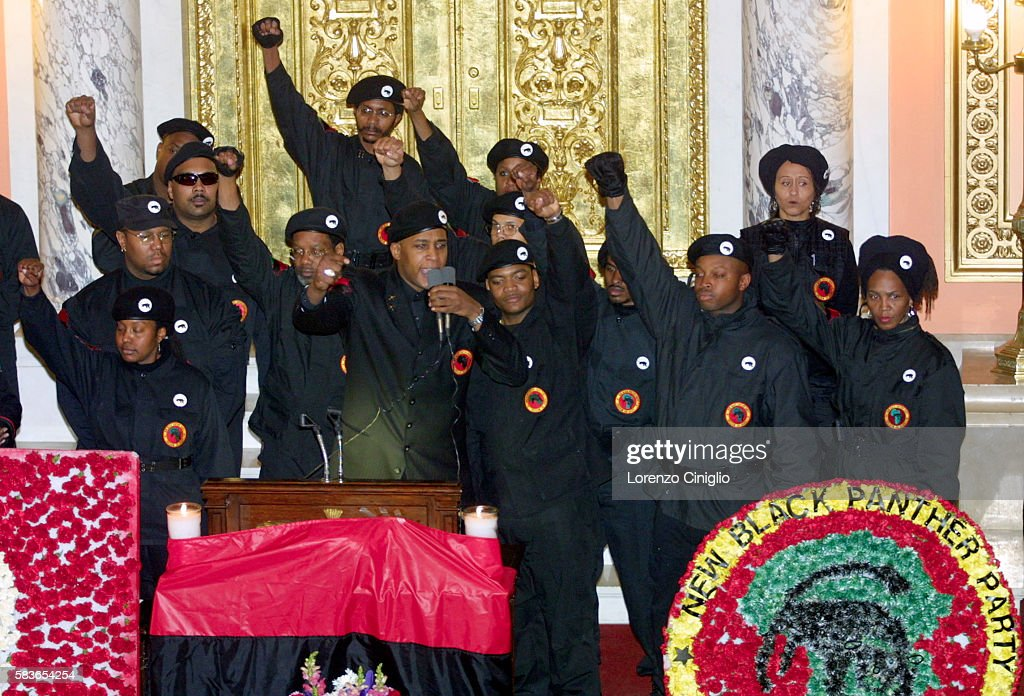 Members Of The New Black Panther Party Raise Their Fists In Salute
