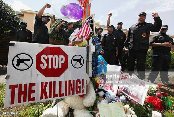 Members of the New Black Panther Party rally next to a memorial to Trayvon Martin outside The Retreat at Twin Lakes community where Trayvon was shot...