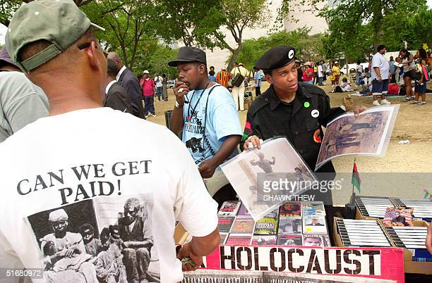 Members of the New Black Panther Party sell prints of early 20th century lynchings 17 August, 2002 during a rally for Reparations for Slavery on the...