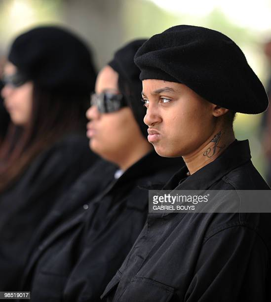 Members of the New Black Panthers group prepare to attend a demonstration of counterprotesters after the neonazi group The American National...